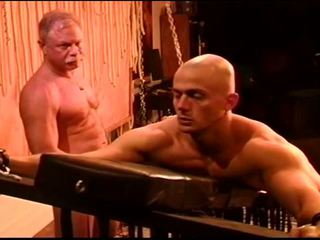 Caning muscle stud as he writhes,screams