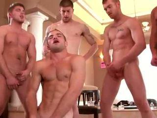 Well built studs enjoying a gay orgy