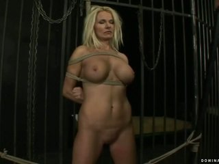 Busty MILF gets bondaged and fucked
