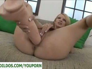Small blonde with a very big dildo