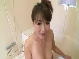 Asian mature in shower sucks on cock b...