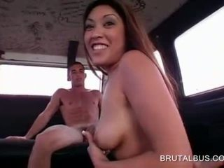 Asian hottie orally pleasing cock in the bus