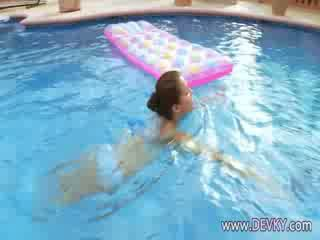 Busty brunette in the pool