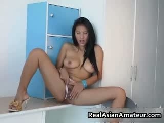 Big boobed asian hottie stuffing her
