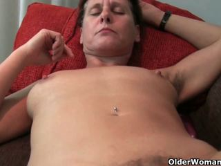 Mature mom's hairy pussy gets the...