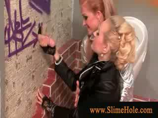 Girls making out surprised by the cock at the gloryhole