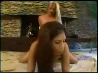 TS and girl 69 pose petting and fucking by the fireplace