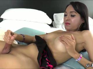 Sweet looking ladyboy Namtan hand surfs her beefy cock