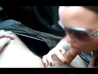 Ponytailed brunette suck his cock in the car Video