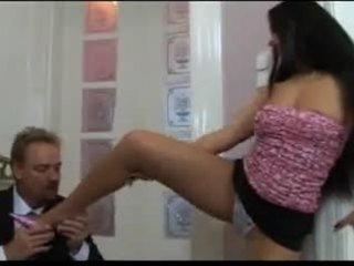 Girl gives a footjob