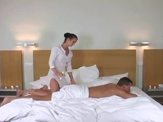 Sexy brunette masseuse gets seduced and fucked