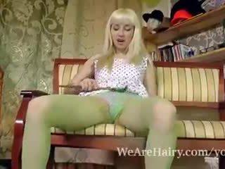 Hairy girl Sasha K plays with green fishnets