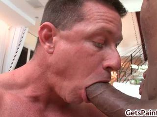 Aged Muscle Lad Sucking Black Cock