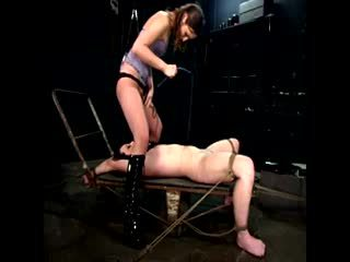 Dominatrix rubs her pussy in a slaves face
