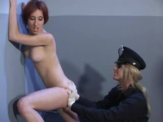 Female cop finger fucks the detainee