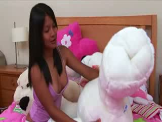 Thai chick rubbing the pussy button