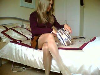 Blonde crossdresser is smoking alone