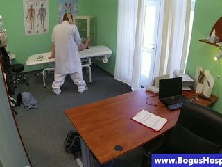 Brunette patient getting oral from her doctor