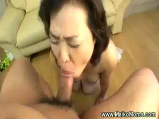 Mature Japanese Milf On Her Knees Sucking Cock