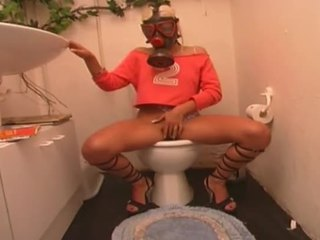 Gas Mask Wearing Euro German Slut Masturbates In The Toilet