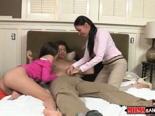Mommy teaching him how to lick her step daughter's pussy right