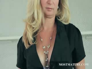 Mature blonde undresses projection totons