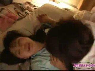 Asian girl in pijama masturbating licking and fingering othe