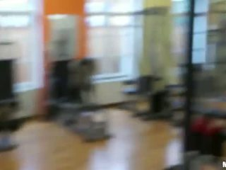 Flirty redhead sweetie fucked in the gym