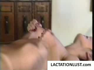 Blonde hottie milking tits on table