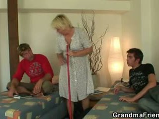 Blond granny swallows two cocks