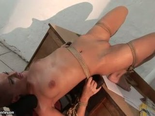 Shorty haired brunette lesbian loves to be tied and dominated