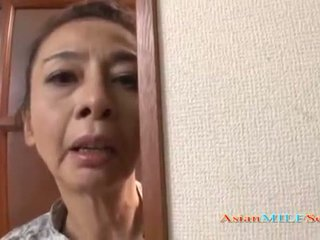 Mature Asian woman in a thong sucks a dick