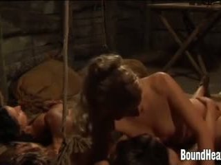 Mistress and Her Strapon Against Naked Slaves