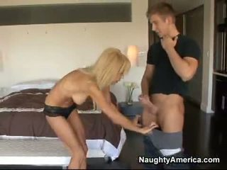 Hawt Cougar Erica Lauren Fills Her Indecent Throat With An Awesome Young Cock