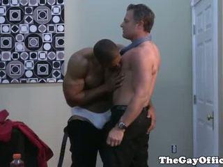 Ebony office hunk sucking white cock