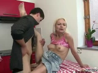 Guy fucks his mother in law right at the kitchen