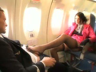 Beautiful stewardess sucking a hard penis