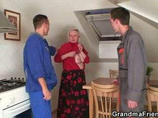 Nasty granny spreads her legs for two cocks